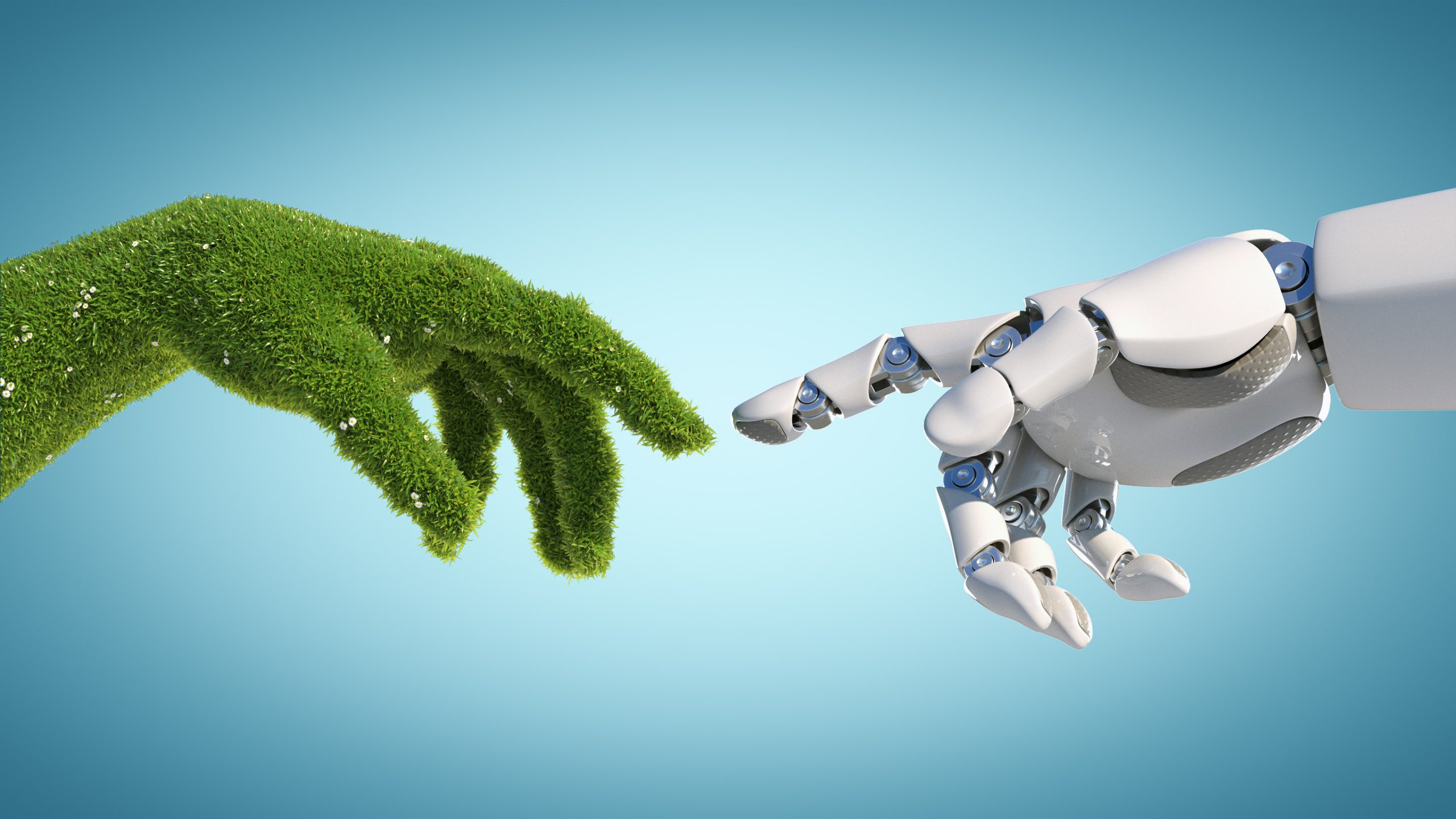 Nature and technology abstract concept, robot hand and natural hand covered with grass